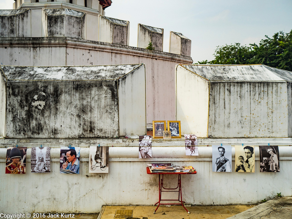 18 OCTOBER 2016 - BANGKOK, THAILAND: Photos of Bhumibol Adulyadej, the King of Thailand, hanging on the wall of Pom Mahakan Fort, one of the original forts that protected Bangkok in the early 1800s. King Bhumibol Adulyadej died Oct. 13, 2016. He was 88. His death came after a period of failing health. Bhumibol Adulyadej was born in Cambridge, MA, on 5 December 1927. He was the ninth monarch of Thailand from the Chakri Dynasty and is also known as Rama IX. He became King on June 9, 1946 and served as King of Thailand for 70 years, 126 days. He was, at the time of his death, the world's longest-serving head of state and the longest-reigning monarch in Thai history.     PHOTO BY JACK KURTZ