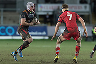 Ollie Griffiths of the Newport Gwent Dragons takes on Jamie Ritchie of Edinburgh. Guinness Pro12 rugby match, Newport Gwent Dragons  v Edinburgh rugby at Rodney Parade in Newport, South Wales on Sunday 27th November 2016.<br /> pic by Simon Latham, Andrew Orchard sports photography.