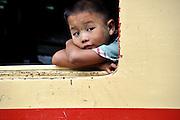 Young Burmese child in a train in Hispaw, Myanmar