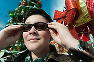 Caleb Longwell, 12, tries on his new pair of glasses in Mesilla, N.M. on Saturday, Dec. 19, 2015, which help correct for the colorblindness he has experienced all of his life. Longwell won a free pair of prescription glasses in a nationwide contest sponsored by EnChroma and Clorox.