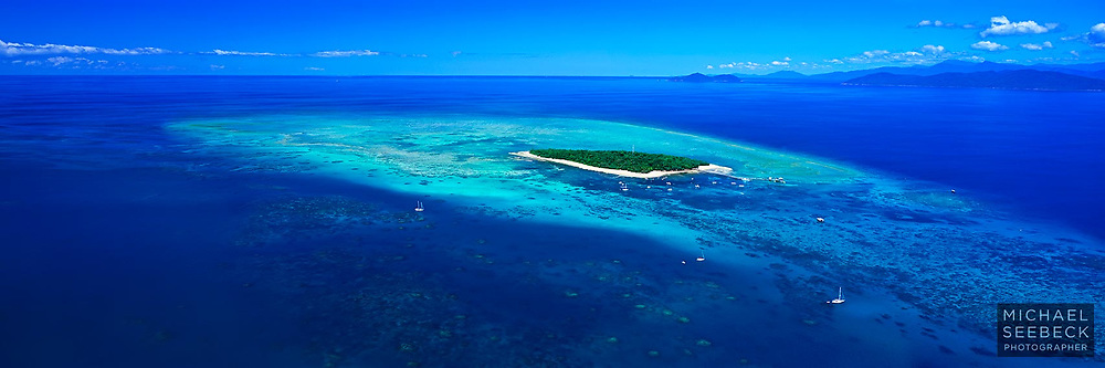 An aerial panoramic photograph of Green Island on the Great Barrier Reef, on a perfect day.<br /> <br /> Code: HAQI0003