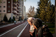 Young women walk through Alparslan Park in Kayseri, amongst morning joggers and people doing exercise.