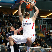 Olympiacos's Pero Antic (R) during their Turkish Airlines Euroleague Basketball Top 16 Group E Game 4 match Anadolu Efes between Olympiacos at Sinan Erdem Arena in Istanbul, Turkey, Wednesday, February 08, 2012. Photo by TURKPIX
