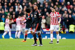 Anthony Martial of Manchester United looks dejected after Stoke City score the opening goal - Mandatory byline: Rogan Thomson/JMP - 26/12/2015 - FOOTBALL - Britannia Stadium - Stoke, England - Stoke City v Manchester United - Barclays Premier League - Boxing Day Fixture.
