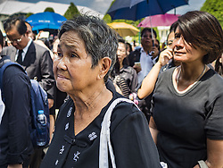 October 14, 2016 - Bangkok, Bangkok, Thailand - People wait in line in front of the Sahathai Samakom Pavilion at the Grand Palace in Bangkok to pay respects to Bhumibol Adulyadej, the King of Thailand, who died Oct. 13, 2016. He was 88. His death comes after a period of failing health. With the king's death, the world's longest-reigning monarch is Queen Elizabeth II, who ascended to the British throne in 1952. Bhumibol Adulyadej, was born in Cambridge, MA, on 5 December 1927. He was the ninth monarch of Thailand from the Chakri Dynasty and is known as Rama IX. He became King on June 9, 1946 and served as King of Thailand for 70 years, 126 days. He was, at the time of his death, the world's longest-serving head of state and the longest-reigning monarch in Thai history. (Credit Image: © Jack Kurtz via ZUMA Wire)