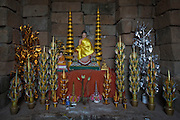 A Budhist shrine with a Buddha statues and ornate decorations within the central tower of the ancient Preah Ko temple, Roluos, Svay Chek District, Banteay Meanchey Province, Cambodia, South East Asia.  The tower is made of brick and is dedicated to Jayavarman II, the founder of the Khmer empire.  (photo by Andrew Aitchison / In pictures via Getty Images)