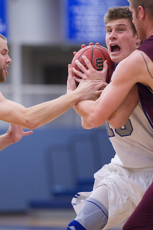 Connor O'Neil, of Colby College, in a NCAA Division III basketball game against the University of Maine Farmington on November 19, 2013 in Waterville, ME. (Dustin Satloff/Colby College Athletics)