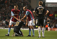 Photo: Rich Eaton.<br /> <br /> Aston Villa v West Ham. The Barclays Premiership. 03/02/2007. Nigel Quashie #33 of West Ham is commiserated at the end of the game by Gary Cahill left and Gavin McCann right of Aston Villa who win 1-0
