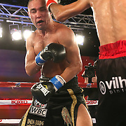 Sergei Lipinets (L) is seen fighting with Cosme Rivera during a Telemundo Boxeo boxing match at the A La Carte Pavilion on Friday,  March 13, 2015 in Tampa, Florida.  (AP Photo/Alex Menendez)