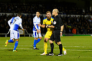 Scott Wagstaff (7) of AFC Wimbledon talks to the referee after a goal was disallowed for a foul on goalkeeper Jack Bonham (13) of Bristol Rovers during the EFL Sky Bet League 1 match between Bristol Rovers and AFC Wimbledon at the Memorial Stadium, Bristol, England on 23 October 2018.