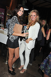 Left to right, ANITA KAUSHIK and KIMBERLY GARNER at a party to celebrate the launch of the Tara Smith Vegan Haircare range held at Sketch, 9 Conduit Street, London on 26th September 2012.