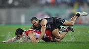 Eddie Betts of the Blues tackles Nick Smith of the Swans during the 2013 AFL Round 14 match between the Sydney Swans and the Carlton Blues at the SCG, Sydney on June 28, 2013. (Photo: Craig Golding/AFL Media)