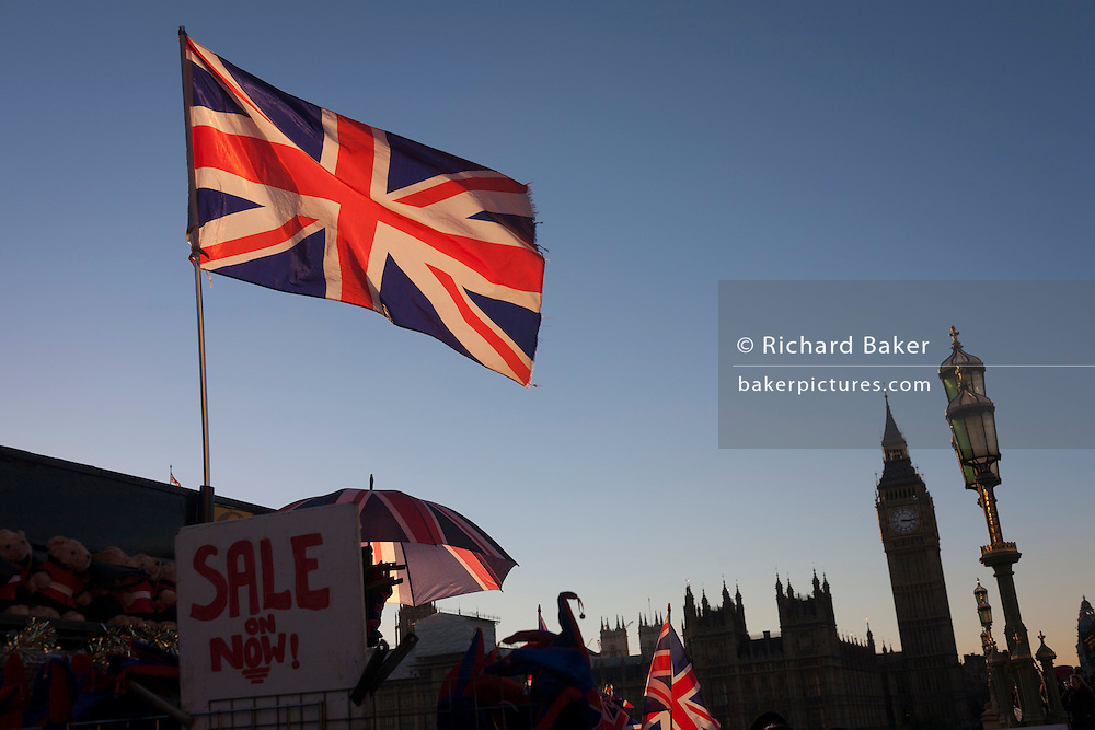 British union jack flags are in the foreground with Big Ben and the Houses of Parliament in the distance, on 29th November 2016, in London, England.
