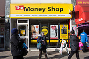 A street view of the shop front of The Money Shop in Lewisham, London, United Kingdom.  The shop offers pawnbroking, money loans, money transfers and foreign exchange.  These shops are often found in poor and deprived areas of the country.
