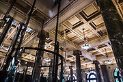Open Sydney presented by Sydney Living Museuems. This event every year allows Sydneysiders to visit 40 of the city's most significant buildings and spaces across the CBD. Interior views of Macquarie Bank Building, 50 Martin Place, Sydney, showing glass lift and the ground-floor banking chamber ceiling.