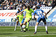 Sam McQueen of Southend United (c) tries to control the ball in the Wigan area. Skybet football league one match , Wigan Athletic v Southend Utd at the DW Stadium in Wigan, Lancs on Saturday 23rd April 2016.<br /> pic by Chris Stading, Andrew Orchard sports photography.