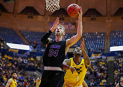 Mar 20, 2019; Morgantown, WV, USA; Grand Canyon Antelopes guard Tim Finke (24) shoots under the basket  during the first half against the West Virginia Mountaineers at WVU Coliseum. Mandatory Credit: Ben Queen