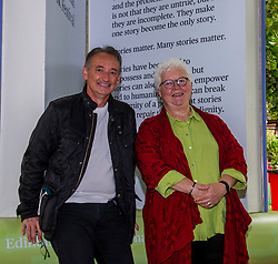 Pictured: <br />Author Val McDermid met up with ex-footballer and commentator Pat Nevin in Edinburgh today. <br /><br />Patrick Kevin Francis Michael Nevin is a Scottish retired footballer. In a 20-year career, he played for Clyde, Chelsea, Everton, Tranmere Rovers, Kilmarnock and Motherwell as a winger. He won 28 caps for Scotland, scattered across a ten-year international career, and was selected for the UEFA Euro 1992 finals squad.<br /><br /> Val McDermid, FRSE, FRSL is a Scottish crime writer, best known for a series of novels featuring clinical psychologist Dr. Tony Hill in a grim sub-genre that McDermid and others have identified as Tartan Noir. At Raith Rovers football stadium, a stand has been named after McDermid. <br /><br />Ger Harley | EEm 15 August 2021