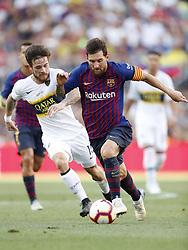 (L-R) Nahitan Nandez of CA Boca Juniors, Lionel Messi of FC Barcelona during the Trofeu Joan Gamper match between FC Barcelona and Boca Juniors at the Camp Nou stadium on August 15, 2018 in Barcelona, Spain