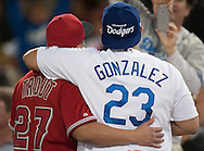 An Angels fan and a Dodgers fan take a photo together during their Freeway Series game Friday night at Dodger Stadium.<br /> <br /> <br /> ///ADDITIONAL INFO:   <br /> <br /> freeway.0402.kjs  ---  Photo by KEVIN SULLIVAN / Orange County Register  --  4/1/16<br /> <br /> The Los Angeles Angels take on the Los Angeles Dodgers at Dodger Stadium during the Freeway Series Friday.<br /> <br /> <br />  4/1/16