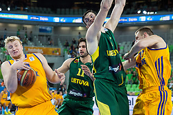 Maxym Korniyenko #12 of Ukraine passes the ball to Kyryl Natyazhko #10 of Ukraine during basketball match between national team of Ukraine and Lithuania of Eurobasket 2013 on September 15, 2013 in SRC Stozice, Ljubljana, Slovenia. (Photo By Matic Klansek Velej / Sportida.com)