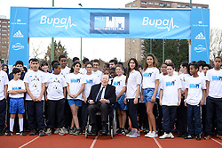© Licensed to London News Pictures. 26/02/2014. © London News Pictures. 26/02/2014. London, UK. SIR ROGER BANNISTER, the first man to run a sub-four minute mile, at a photocall at Paddington Recreation ground in London to launch the 2014 Bupa Westminster Mile in May 2014, which will officially celebrate the 60th anniversary. The track at Paddington Recreation ground was where Sir Roger Bannister trained for the record attempt. Photo credit: Mike King/LNP