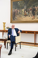 """02 FEB 2021, BERLIN/GERMANY:<br /> Frank-Walter Steinmeier, Bundespraesident, waehrend einem Interview, unter dem historische Gemaelde """"Die Parteigänger"""" des Landauer Historienmalers Carl Wendling, Robert-Blum-Saal, Schloss Bellevue<br /> IMAGE: 20210202-01-011<br /> KEYWORDS: Bundespräsident"""