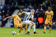 James McClean of West Bromwich Albion © tackles Mousa Dembele of Tottenham Hotspur (l).Premier league match, West Bromwich Albion v Tottenham Hotspur at the Hawthorns stadium in West Bromwich, Midlands on Saturday 15th October 2016. pic by Andrew Orchard, Andrew Orchard sports photography.