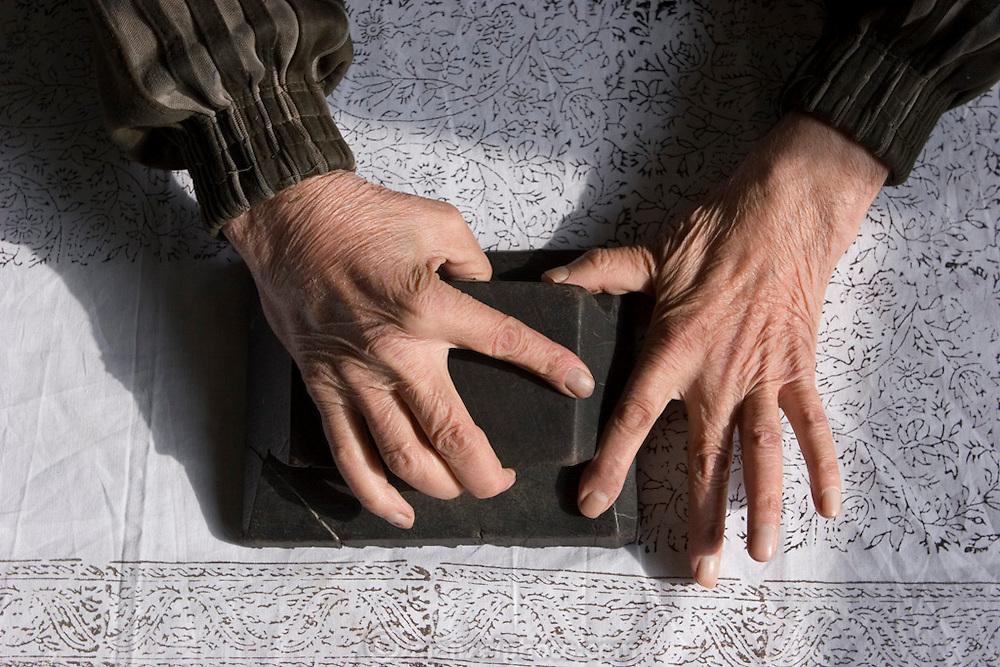 Harjeza Sedighi Fard, 75, hand block-printing cotton fabric in the bazaar at Isfahan, Iran.