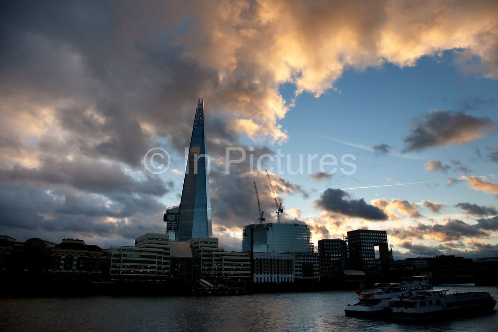 London's latest skyscraper, the Shard (aka The Shard of Glass) on the south side of the city near London Bridge against a strong cloud filled sky. The tallest building in Europe The tower stands at 310 m (1,017 ft) tall and has 72 floors, plus 15 further floors in the roof. Renzo Piano, the building's architect, worked together with architectural firm Broadway Malyan during the planning stage of the project. After a lengthy public inquiry, the collaboration successfully achieved its objective, and the developers were granted full planning permission in November 2003.