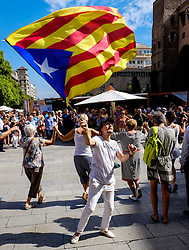 A man waving the Estelada (Catalonian flag of independence) in the Palau de la Generalitat de Catalunya near Barcelona Cathedral<br /> <br /> (c) Andrew Wilson | Edinburgh Elite media