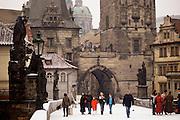 Charles Bridge in winter with snow. Prague, Czech Republic.