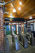 The subway station at Avenue H in Brooklyn was originaly built as a real estate office in the early 20th century. Converted to a subway station entrance, the porch is set with bronze rocking chairs by Ed Kopel, and invites relaxing.
