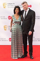 © Licensed to London News Pictures. 13/05/2018. London, UK. KONNIQ HUQ and CHARLIE BROOKER arrives for the Virgin TV British Academy (BAFTA) Television Awards. Photo credit: Ray Tang/LNP