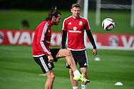 Simon Church of Wales (r) and Gareth Bale of Wales during the Wales football team training session at the Vale Resort, Hensol Castle near Cardiff ,South Wales on Monday 31st August  2015. The team are preparing for their next EURO 2016 qualifying match away to Cyprus later this week.<br /> pic by Andrew Orchard, Andrew Orchard sports photography.