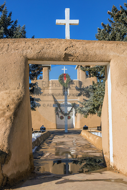 Entrance to the historic San Francisco de Asis Mission Church in Ranchos de Taos Plaza, Taos, New Mexico. The adobe church built in 1772 and made famous in paintings by artist Georgia O'Keeffe.