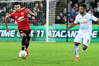 Football - 2017 / 2017 EFL (League) Cup - Fourth Round: Swansea City vs. Manchester United<br /> <br /> Jesse Lingard of Manchester United attacks chased by Wayne Routledge of Swansea City, at The Liberty Stadium.<br /> <br /> COLORSPORT/WINSTON BYNORTH