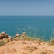 Stack of stones on Promthep cape with Andaman sea on background, Phuket, Thailand