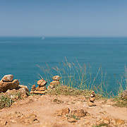 Stack of stones on Promthep cape with Andaman sea on background, Phuket, Thailand