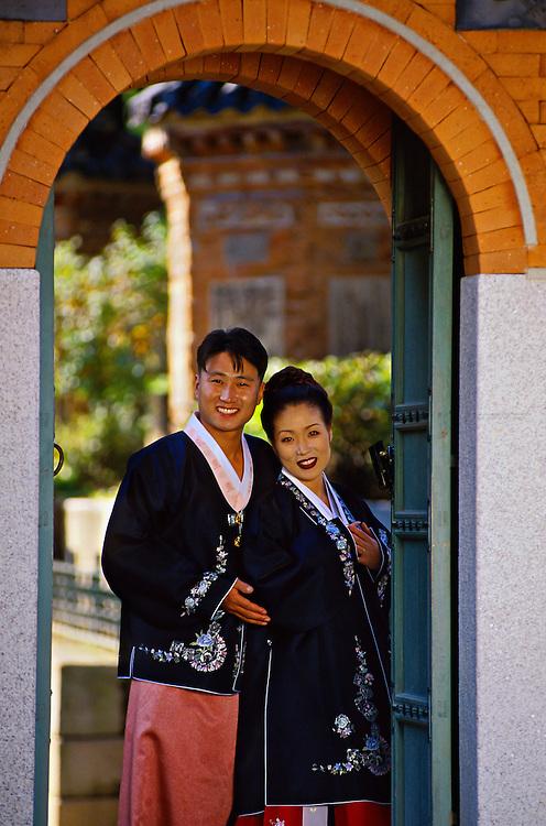 Korean bride and groom posing for wedding photo at Kyongbokkung Palace, Seoul, South Korea