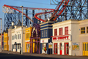 An empty Blackpool Pleasure Beach, closed during the pandemic, on 21st April 2021 in Blackpool, Lancashire, United Kingdom. Blackpool is a large town and seaside resort in the county of Lancashire on the north west coast of England. Blackpool was once a booming resort with it's famous promenade which now, despite having a somewhat shabby appearance, still continues to attract millions of visitors each year. During the coronavirus pandemic however, Blackpool has struggled, with empty streets and closed down businesses creating an atmosphere more like a ghost town.