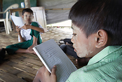 Thant Zaw Oo (12) studies in a small emergency school constructed of waterproof tarpaulins given by USAID. This is an area that was extremely badly affected by Cyclone Nargis, with all families sufferin the loss of family members. Kyaung Shargyi Village, Laputta, Myanmar.