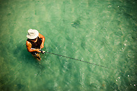 A woman fishes the flats on Big Hickory Pass on Bonita Beach in Southwest Florida.