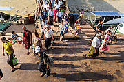 """17 JUNE 2013 - YANGON, MYANMAR:  Passengers board the Yangon-Dala Ferry to go Dala. The ferry to Dala opposite Yangon on the Yangon River is the main form of transportation across the river. Every day the ferry moves tens of thousands of people across the river. Many working class Burmese live in Dala and work in Yangon. The ferry is also popular with tourists who want to experience the """"real"""" Myanmar. The rides takes about 15 minutes. Burmese pay about the equivalent of .06¢ US for a ticket.  Foreigners pay about the equivalent of about $4.50 US for the same ticket.   PHOTO BY JACK KURTZ"""
