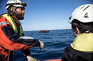 A group of about 60  is transfered from a rescued unflatable boat onto a Sea Watch 3 RHIB (Rigid Hull Inflatable Boat) during a rescue operation by  the German-flagged vessel Sea Watch 3 off Libya's coasts on January 9, 2020. The German charity group Sea Watch on January 9  had rescued about 60 migrants from an inflatable boat, four more boats were spotted in the surroundings. Libyan coast guard intercepted at least two rubber boat.<br /> FEDERICO SCOPPA / AFP