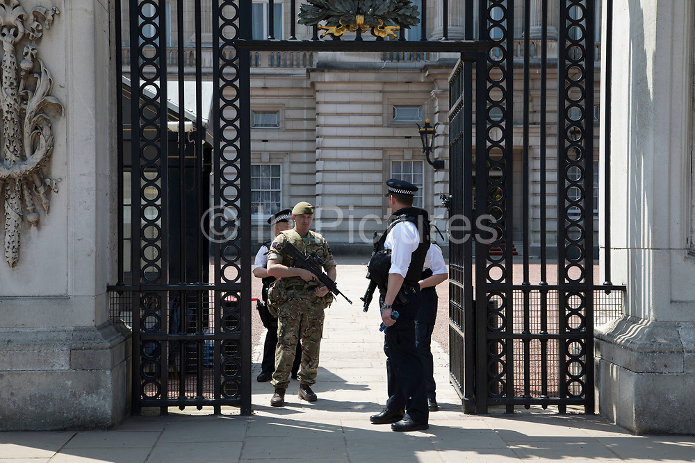 Following recent terror attacks, security is heightened with more armed police on the streets and the Army adding a military presence, policing important buildings, as here at Buckingham Palace in London, England, United Kingdom.