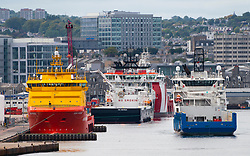 View of North Sea oil industry service vessels  in Aberdeen port , Aberdeenshire, Scotland, UK