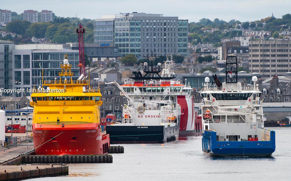 View of North Sea oil industry service vessels  in Aberdeen port , Aberdeenshire, Scotland, UK