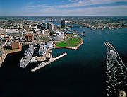 Aerial View: The World War II Battleship Wisconsin at the Nauticus Museum at Norfolk on left. Portsmouth, Virginia on right distance on the Elizabeth River runs between them. Hampton Roads, Chesapeake Bay Region.