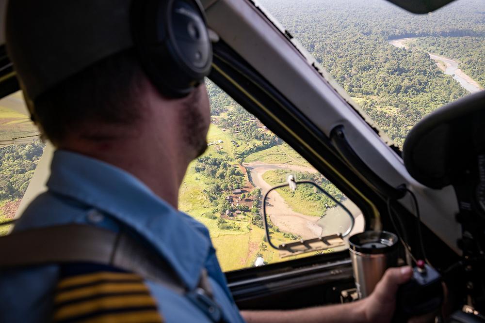 Josh Verdonck, a pilot for Ethnos360 Aviation, circles his Quest Kodiak 100 over the airstrip before landing in Likan, East Sepik Province, Papua New Guinea.<br /><br />(June 20, 2019)